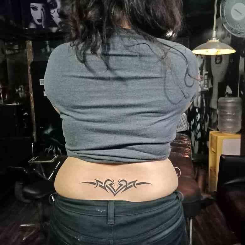 black-master-tattoos-delhi-lower-back-abstract