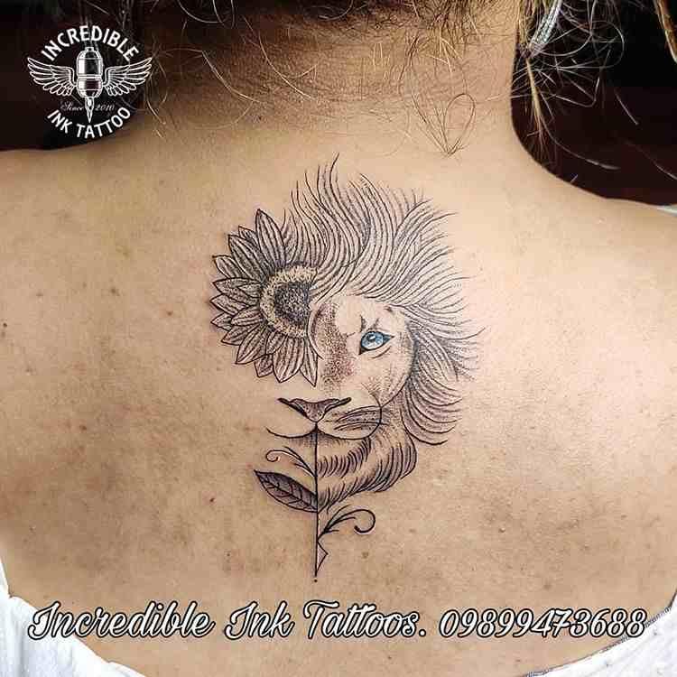 incredible-ink-tattoos-delhi-back-half-flower-lion