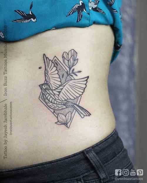Iron-buzz-tattoo-mumbai-bandra-bird-grey-compressed