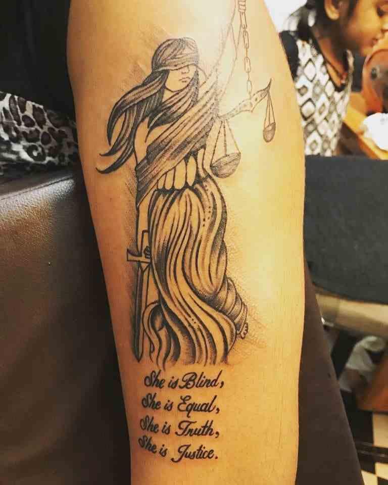 tattoo-guru-mumai-arm-black-law