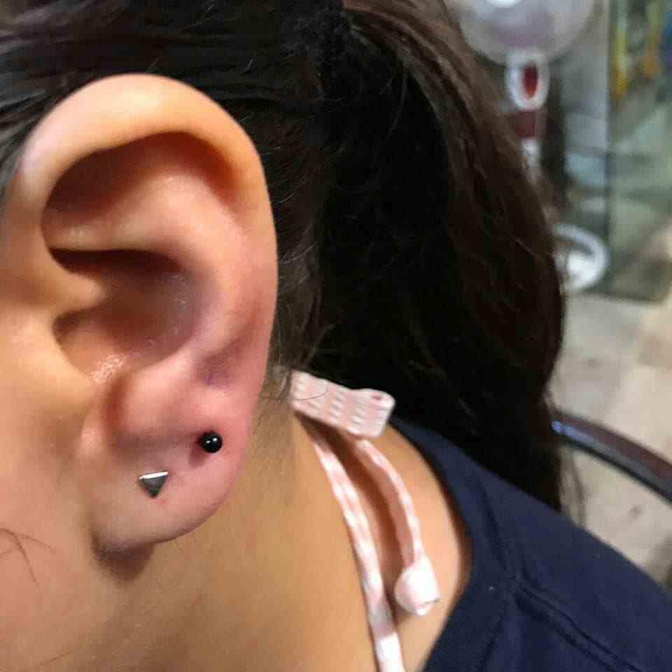 tattoo-guru-mumbai-ear-piercing-closeup