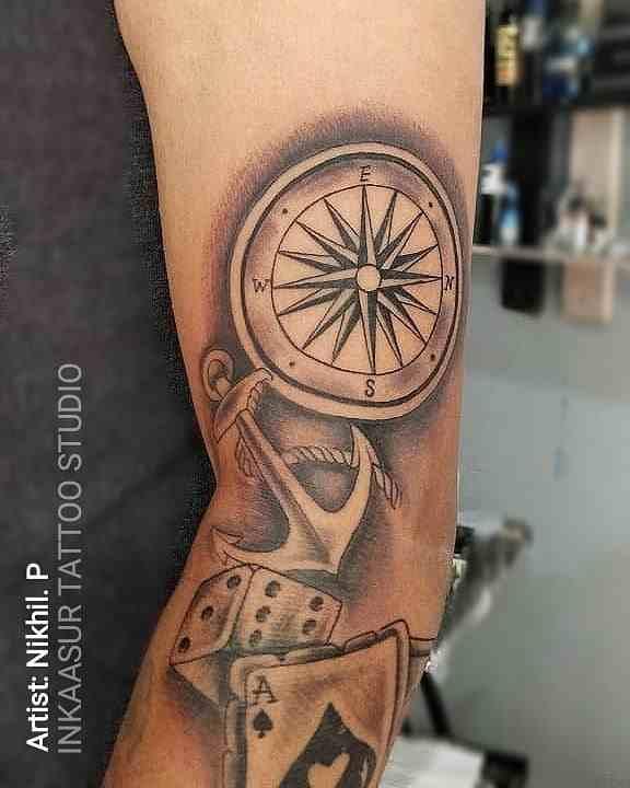 inkaasur-tattoo-studio-pune-hand-abstract-compass