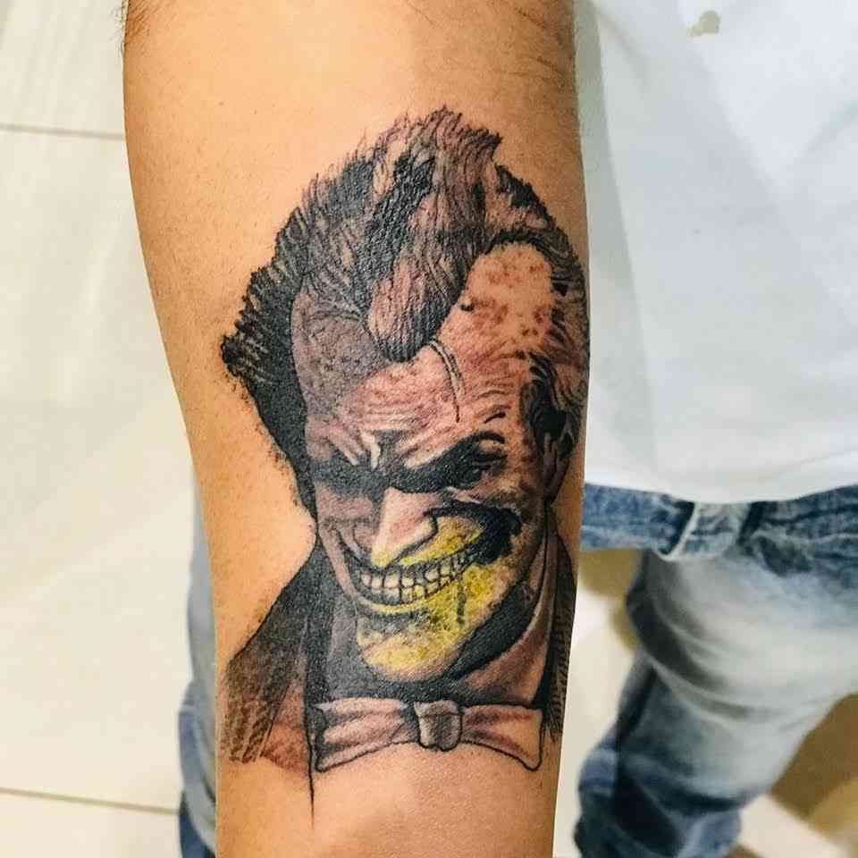 michale-tattoo-pune-arm-joker