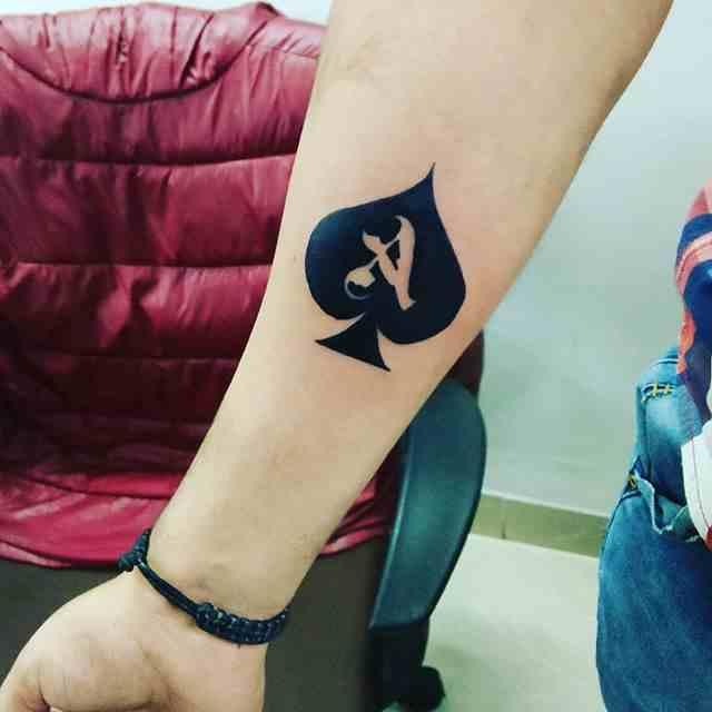 st-michale-tattoo-pune-arm-spade-ace