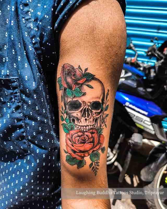 laughing-buddha-tattoos-triprayar-biceip-skull-red-rose